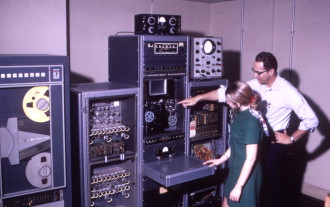 COMPUTERS OF YORE: Technology has advanced over the decades since the federal government started collecting and storing the world's climate data. Before moving to the Federal Building, data was stored in the Grove Arcade. Here, National Climatic Data Center staff members Dale Lipe and Ray Ertzberger use the Film Optical Sensing Device for Input to Computers in the '60s. Photo courtesy of NOAA