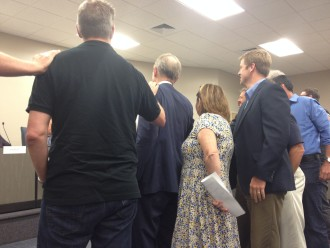 Presenters and members of the public swear in before the Board of Adjustment meeting on Wednesday, July 13. The meetings are quasi-judicial, so everyone speaking must be sworn in.
