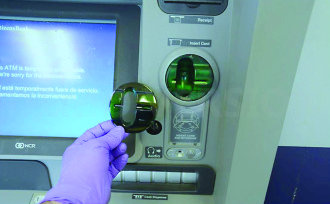 "KNOWING THE RISK: Scam artists are constantly finding new, ingenious ways to exploit security loopholes and gain access to consumers' personal information, from installing ""skimmers"" (pictured above) on unmanned points of transaction to hacking into financial databases. In turn, law enforcement and cyber security experts encourage consumers to protect themselves by being vigilant in knowing how and where scammers strike. Photo courtesy of the Asheville Police Department"