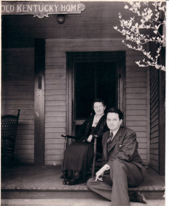 THE OLD KENTUCKY HOME: Thomas and his mother, Julia Wolfe, sit outside her rooming house in May 1937.