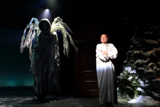 Peter Thomasson performs the role of Scrooge in the Flat Rock Playhouse production of A Christmas Carol.