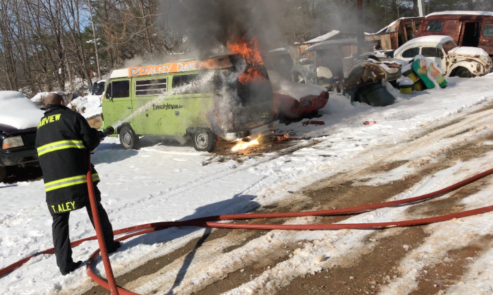 UP IN FLAMES: A firefighter with the Fairview Fire Department douses the flames on Hokey Pokey's van, which contained all of the owner's possessions. Yet the setback has not dimmed the writer's affection for van life. Photo by Hokey Pokey